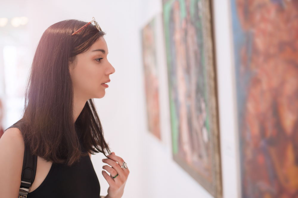 a woman looking at art